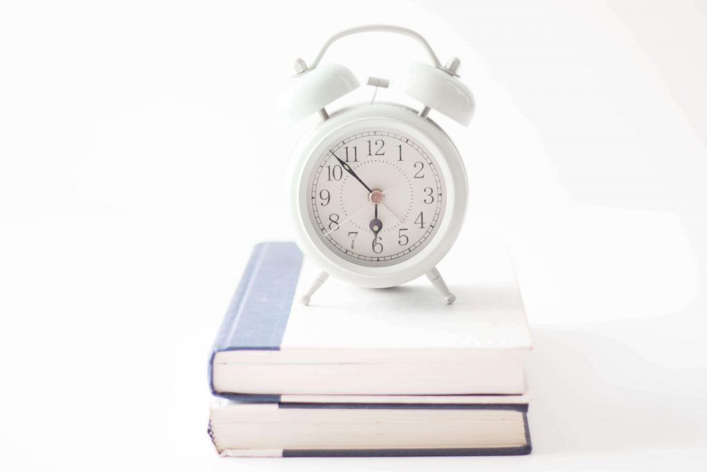 two books with alarm clock on top mom fail