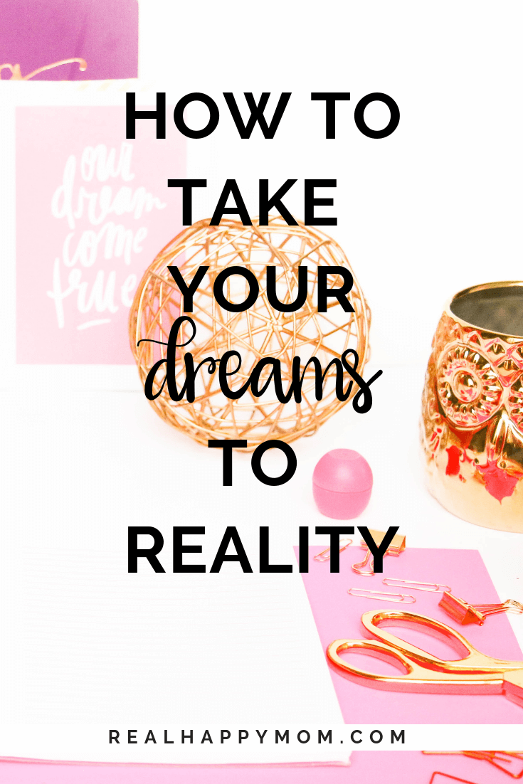 flatlay photo with text overlay with notebook and pen and gold ball, dreams to reality