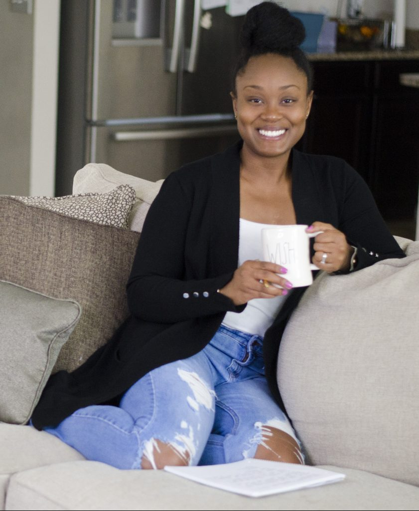 Toni-Ann Mayembe sitting on couch