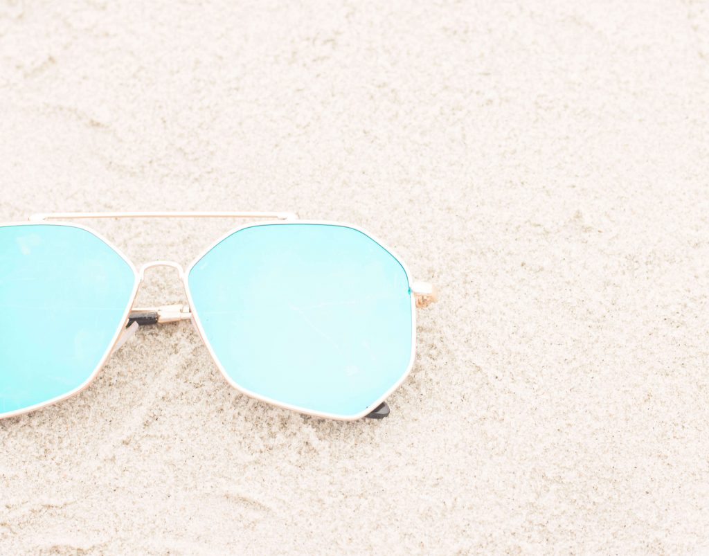 sun glasses on the beach