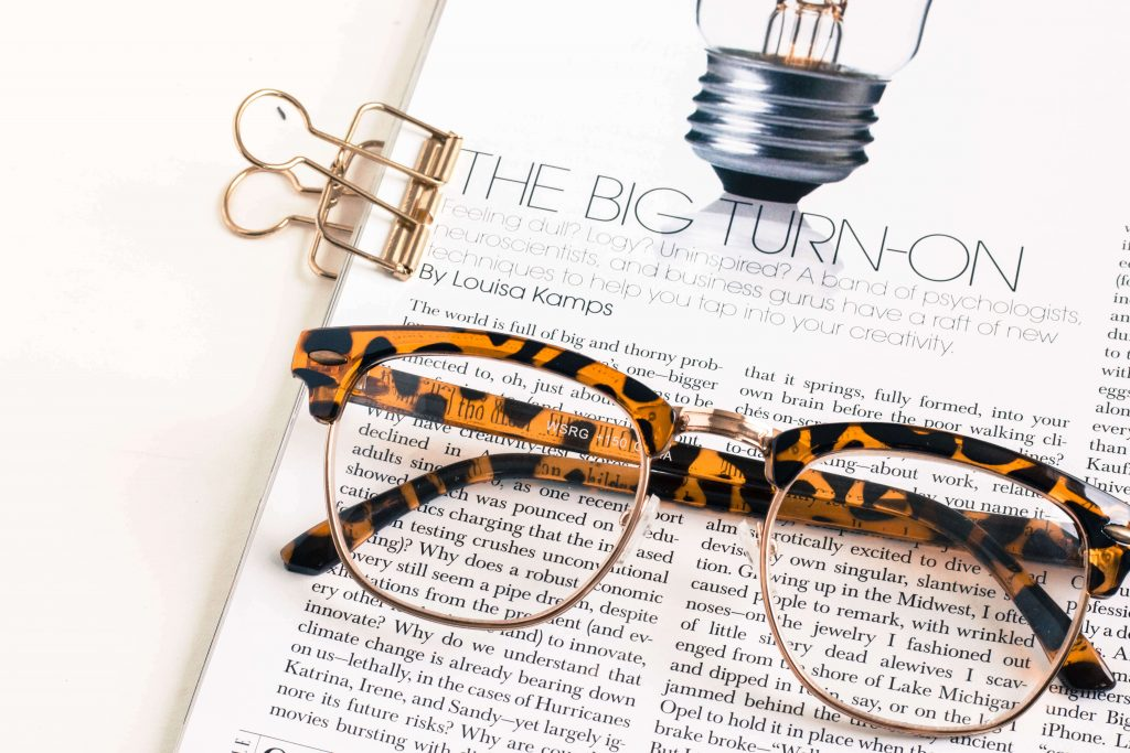 glasses with book and paper clip